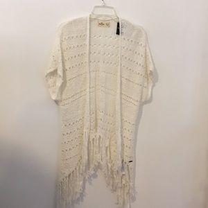 A brand new white cardigan